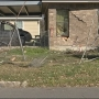 Family cleans up after driver crashes car inside garage